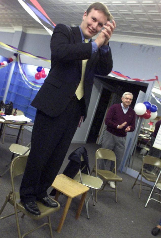 Standing on a chair , Chris Murphy thanks his supporters after results were tallied at Democratic campaign headquarters in Southington Tuesday evening. Murphy defeated challenger Barbara Morelli to retain his 81st Assembly seat.