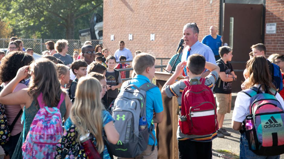 Principal Andrew Batchelder welcomes students to the first day of classes at Wheeler Elementary School in Plainville on Sept. 4, 2018. The school will be undergoing renovations throughout the schoolyear. | Devin Leith-Yessian/Plainville Citizen