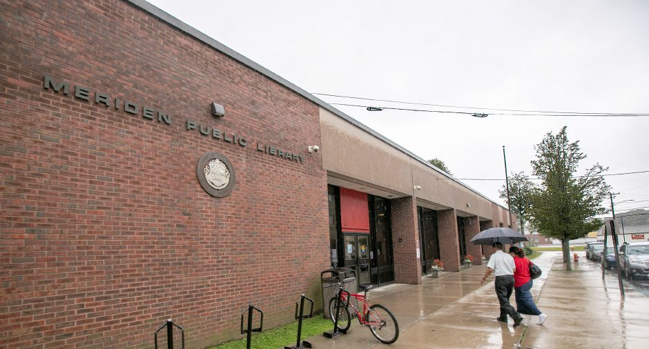 The front entrance of the Meriden Public Library, seen in September 2018. File photo, Record-Journal