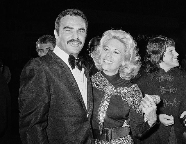 In this Nov. 5, 1971 file photo, actress Dinah Shore and Burt Reynolds appear together in Los Angeles. Associated Press