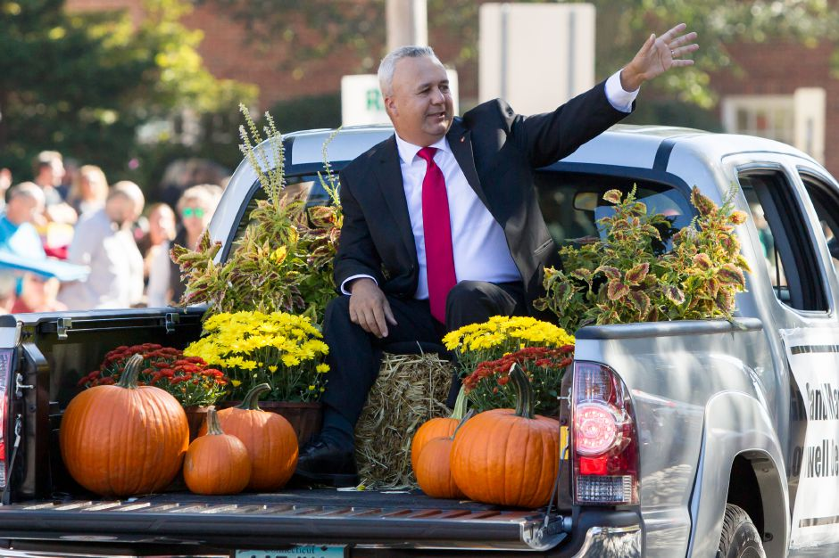 Grand Marshal Lowell DePalma waves to the crowd Sunday during the 49th Apple Harvest Parade in Southington October 1, 2017 | Justin Weekes / For the Record-Journal