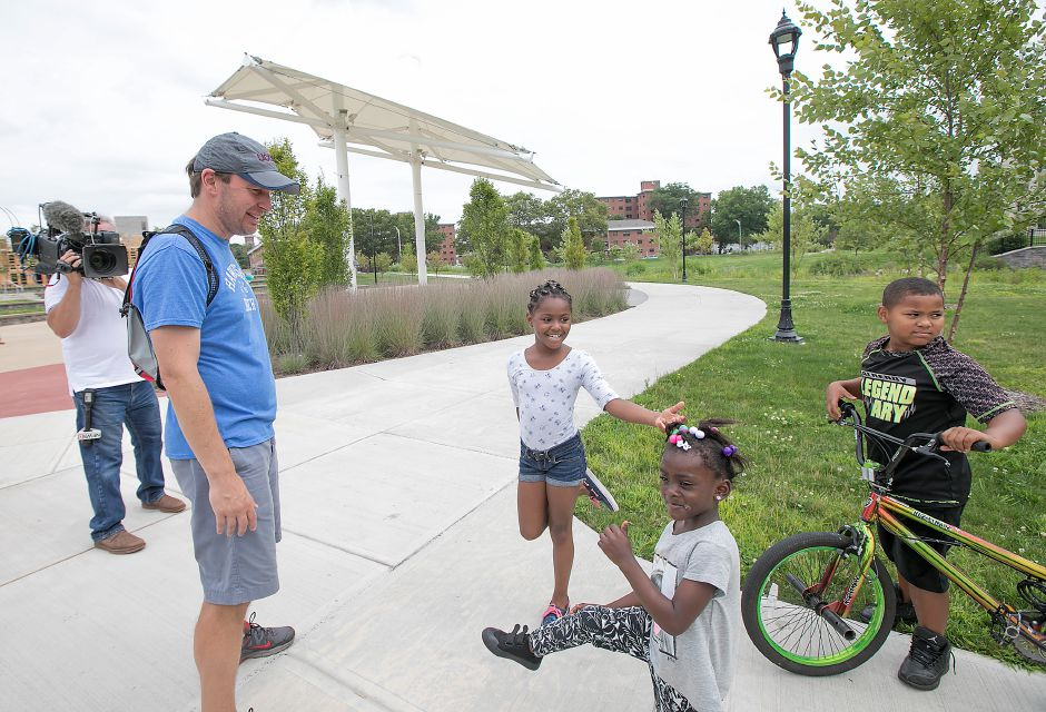 U.S. Senator Chris Murphy greets children, left to right, Jazzniqua Marrow, 8, Leric Green, 5, and William Lyde, 7, all of Meriden, on the Meriden Green, Tuesday, August 15, 2017. | Dave Zajac, Record-Journal