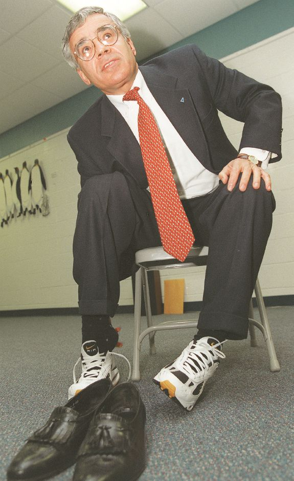 RJ file photo -George Serrano of Canberra Nuclear Products, dons a pair of running shoes at the Meriden YMCA after learning the indoor track was now named after him Jan. 27, 1999.