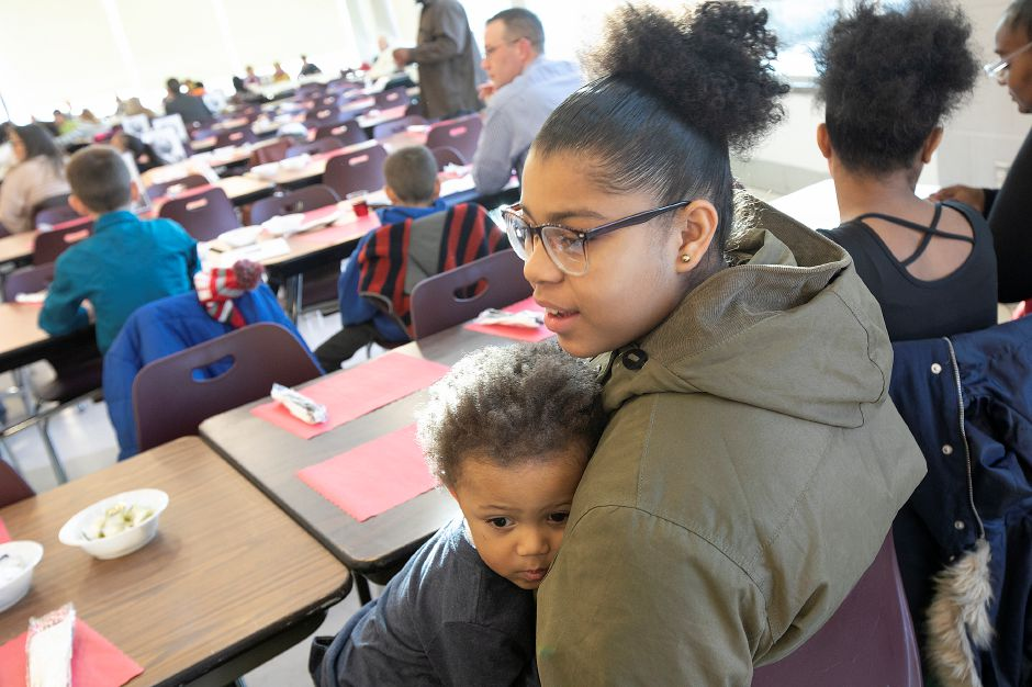 Briana Hutchins, 13, of Meriden, holds nephew Kameron Hutchins, 2, of Middletown, during the 34th annual Martin Luther King Jr./Albert Owens scholarship breakfast at Maloney High School, Mon., Jan. 21, 2019. Dave Zajac, Record-Journal