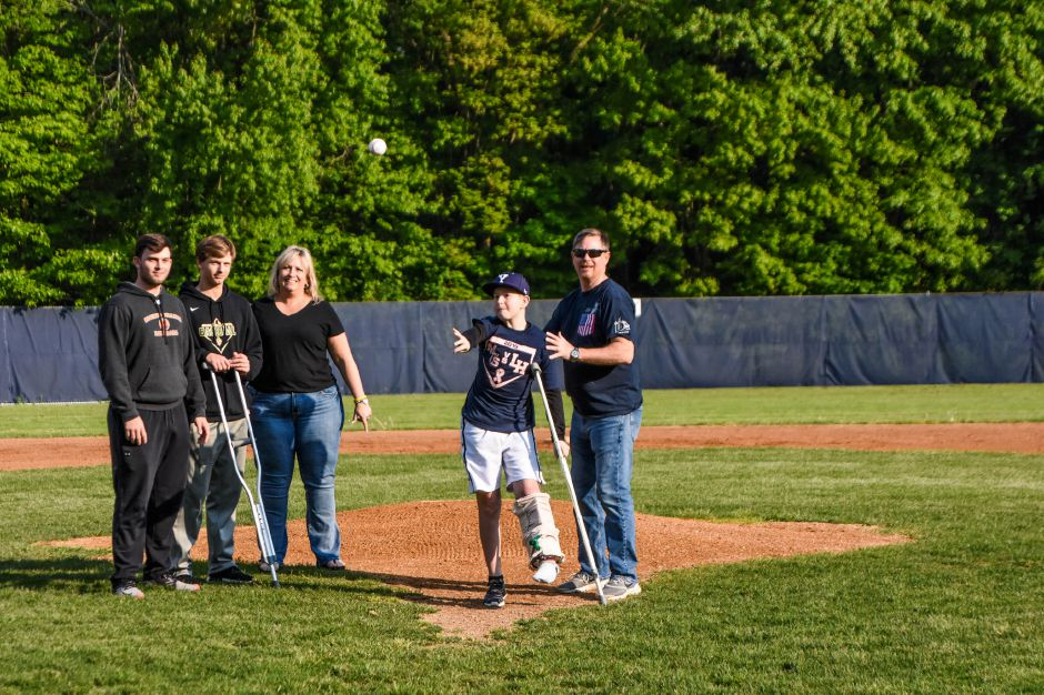 Cole Greib threw out the first pitch prior to Friday evening's Lyman Hall-Sheehan rivalry game at Pat Wall Field. Greib is an an 8th grader at Dag Hammarskjold Middle School | Jim McGovern, Special to the Record-Journal