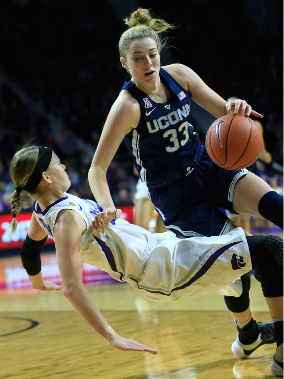 Connecticut's Katie Lou Samuelson (33) charges into Kansas State guard Shaelyn Martin during the first half of Sunday's game in Manhattan, Kan. | Associated Press