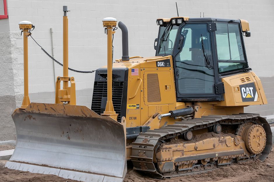 A bulldozer fitted with GPS (the white domes above the plow) helps guide the operator to blueprint building specifications during construction of Tractor Supply Co. at 801 N. Colony Rd. in Wallingford, Friday, August 31, 2018. The property is at the intersection of North Colony Road (Route 5) and Beaumont Road, between Walmart and restaurant Rick's on 5. Dave Zajac, Record-Journal