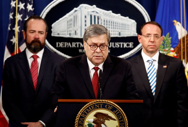 Attorney General William Barr speaks alongside Deputy Attorney General Rod Rosenstein, right, and acting Principal Associate Deputy Attorney General Edward O