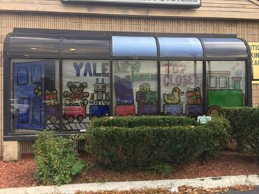 Green Acres Elementary School art teacher Sheri Schwarz and several of her students decorated the window of Now Security Systems on Thursday, Nov. 2, 2017. | Contributed