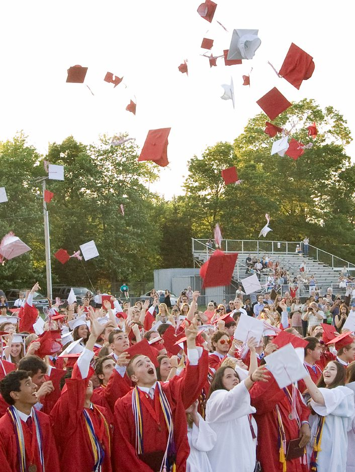 Graduates send their caps flying at conclusion of commencement ceremonies at Cheshire High School, Tuesday, June 24, 2014. | Dave Zajac / Record-Journal