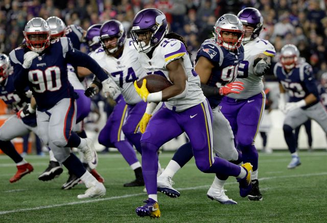 FILE - In this Sunday, Dec. 2, 2018 file photo, Minnesota Vikings running back Dalvin Cook (33) runs against the New England Patriots during the first half of an NFL football game in Foxborough, Mass. One of the Patriots' biggest weaknesses on defense this season has been containing opponents on the ground. New England has allowed 100 or more rushing yards seven times and is coming off giving up a season-high 189 in last week's loss at Miami. A trip to Pittsburgh is next, but for just...