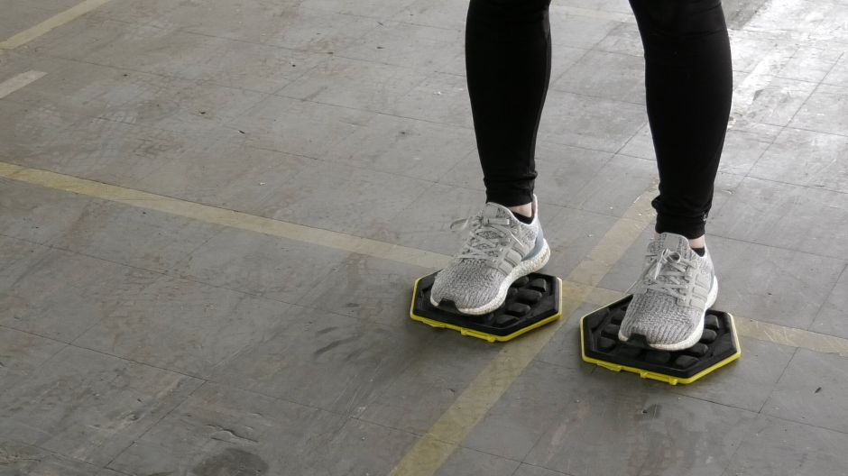 Kristen Dearborn shows how to stand on sliders for lower body workouts. Monday, April 8, 2019. |Ashley Kus, Record-Journal