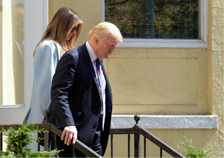 President Donald Trump and first lady Melania Trump leave after attending services at St. John