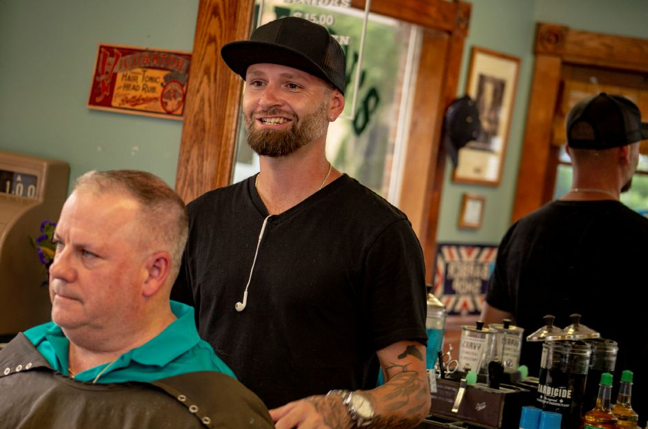 Edward Pratt smiles while talking about Glenn Agnew, the former owner of the South Meriden barber shop, in the newly opened The Gentleman
