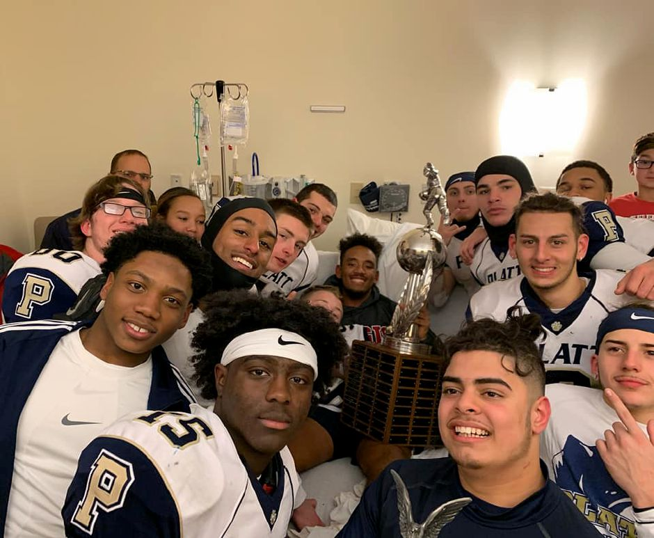 Members of the Platt High School football team visit senior outside linebacker  Chase Bessler at MidState Medical Center. Bessler was hospitalized from Nov. 18-22 with an infection that developed after being cleated on the ankle, causing him to miss the  game against Maloney. For more photos, see myrecordjournal.com. Photo courtesy Yolanda Prioleau