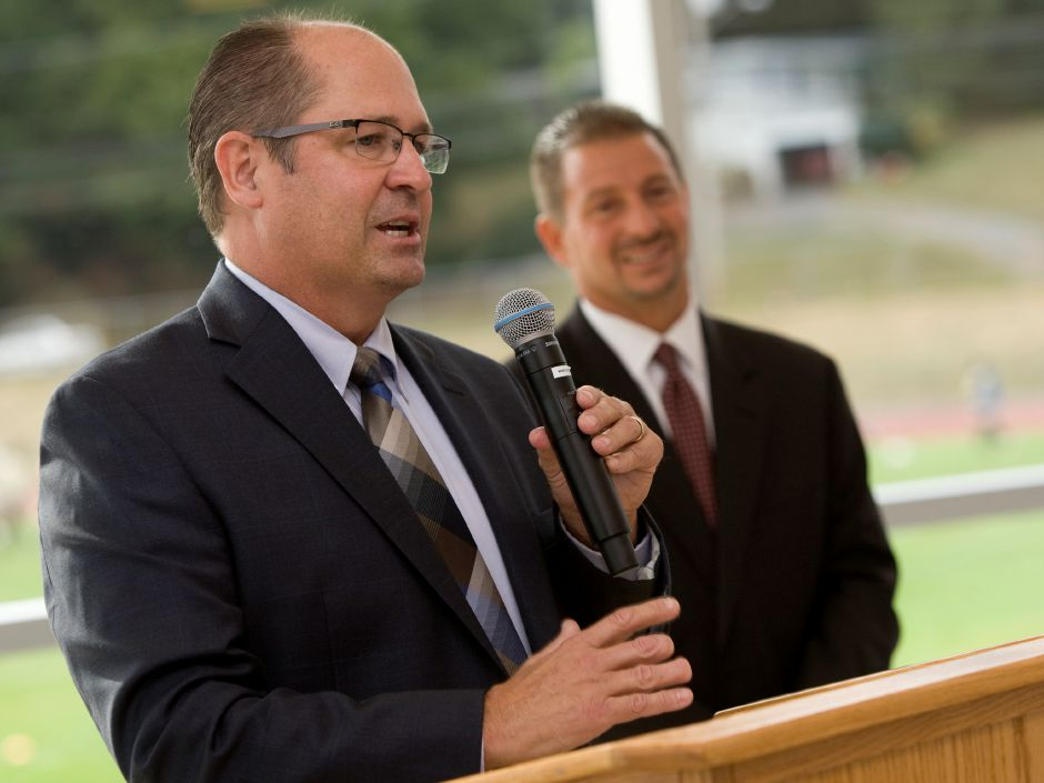 School Principal Robert Montemurro speaks next to School Superintendent Mark D. Benigni during a ceremony marking the completed second phase of construction at Platt High School, Tuesday, September 29, 2015. | Dave Zajac / Record-Journal