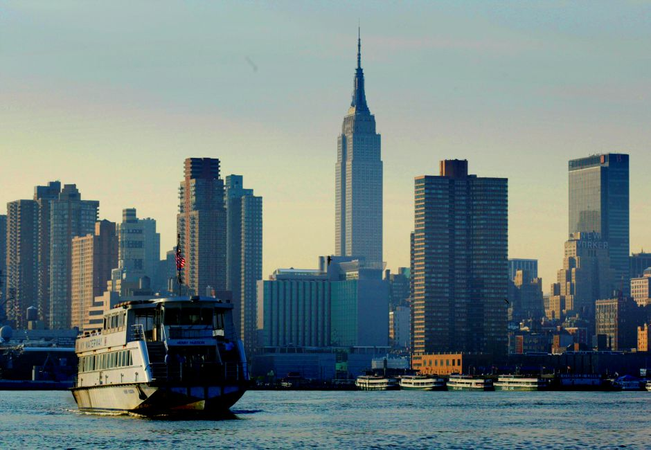 A ferry boat pulls into its dock at Weehawkin, N.J., against the New York skyline Friday, Aug. 15, 2003. With an electrical power blackout closing most public transportation, ferries still carried passengers to and from the city. In the background is the Empire State Building. (AP Photo/George Widman)