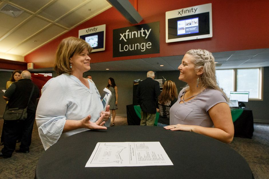 Stacy Dicristina of Waterbury networks with Vicki Gelpke of Meriden Saturday during the 1st Annual Quinnipiac Chamber Manufacturing Job Fair at the Toyota Oakdale Theater in Wallingford September 22, 2018 | Justin Weekes / Special to the Record-Journal