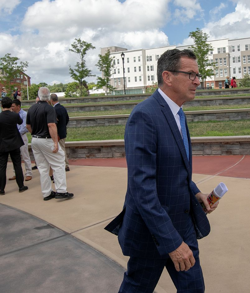 Governor Dannel P. Malloy walks to the Meriden Commons from the Meriden Green, Tuesday, July 24, 2018. State and local leaders, and developers celebrated the completion of the $25 million mixed income Meriden Commons I project and the start of construction on Meriden Commons II. About 100 people attended the ribbon cutting ceremony at the amphitheater on the Meriden Green. Dave Zajac, Record-Journal