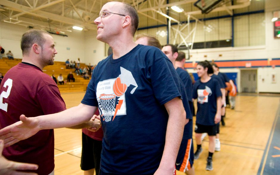 Tom Lipka, a math teacher at Lyman Hall, shakes hands with the Sheehan team after the Faculty Slam basketball game at Lyman Hall in Wallingford, March 22, 2011. (Sarah Nathan/ Record-Journal)
