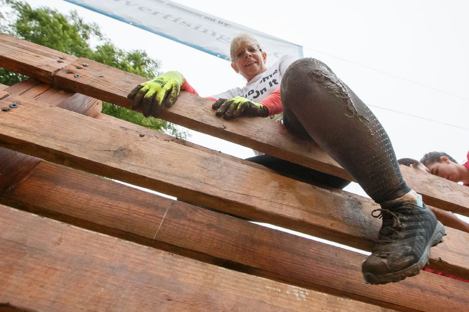 "Susan Ross of Moodus clears the top of ""Stairway to Heaven"" obstacle Saturday during the 5th annual Gaylord Gauntlet 5k Trail & Obstacle Race at Gaylord Hospital in Wallingford June 23, 2018 
