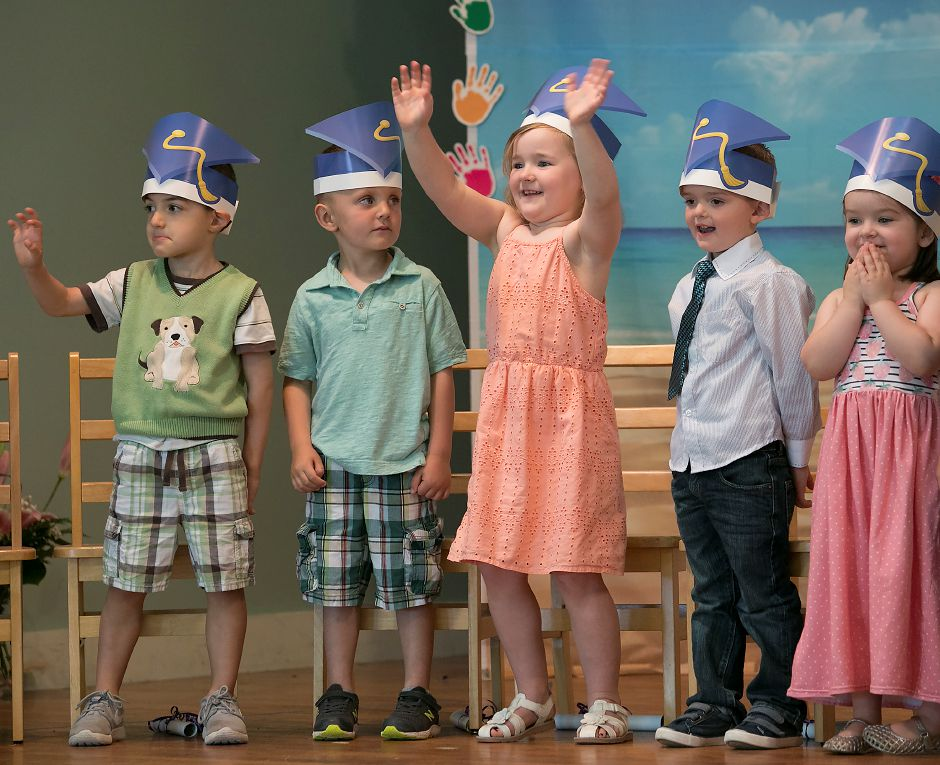 Student, Aubree Lee, 5, center, waves to the audience during graduation at Plantsville Community Nursery School in Southington, Wednesday, May 23, 2018. Plantsville Community Nursery School held its 63rd graduation this week, the final ceremonies for the school, which is closing this year. Dave Zajac, Record-Journal