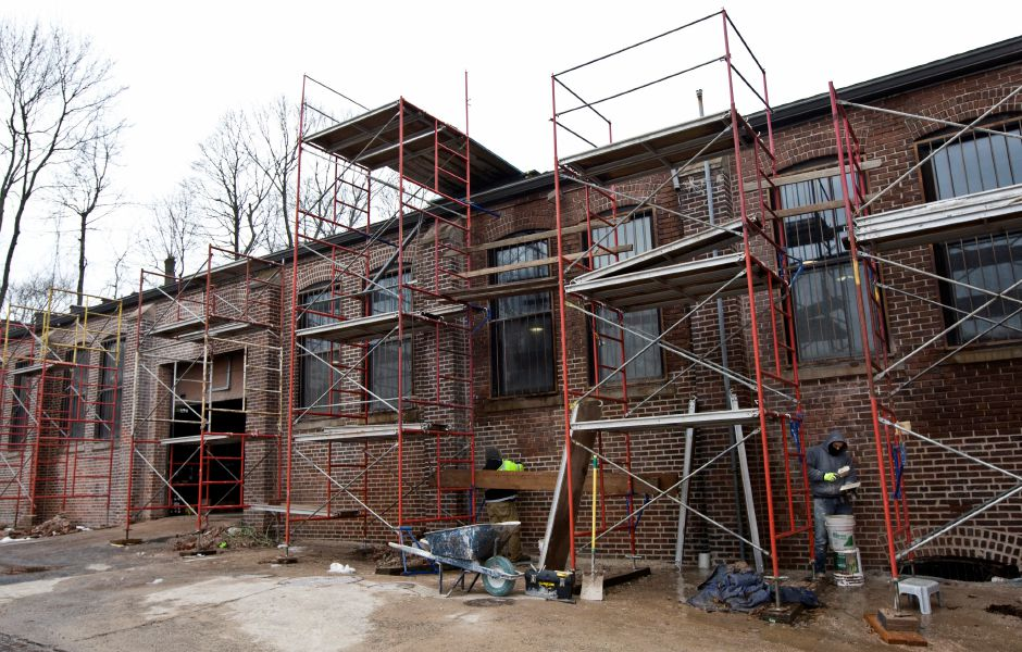 Workers repoint brick on the east side of the former armory at 241 E. Main St. in Meriden, Wednesday, January 25, 2017. Extensive repairs and environmental cleanup have rehabilitated the once blighted building and Trail of Terror founder Wayne Barneschi hopes to have his 'Armory of Darkness' open in time for the Halloween season. | Dave Zajac, Record-Journal