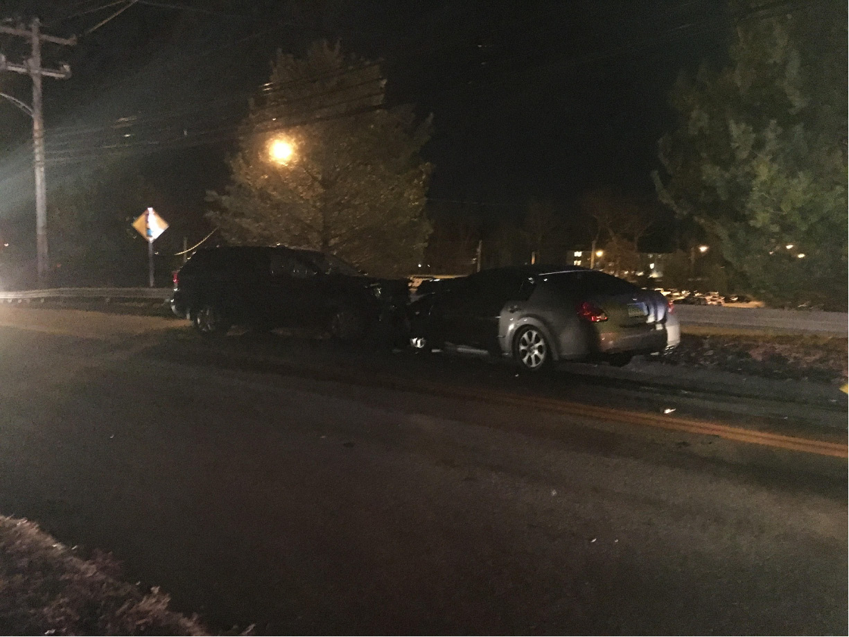 One person was hospitalized and a woman was charged with DUI following a head-on crash Friday evening on Cook Hill Road near Oakdale Theatre. | Lauren Takores, Record-Journal