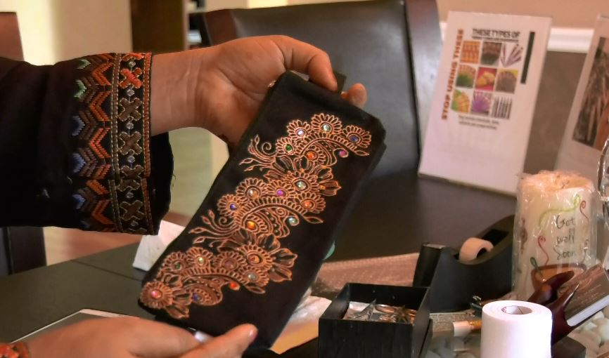 Henna artist Adila Khan also makes henna art pieces like pencil cases and candles. |Ashley Kus, The Record-Journal