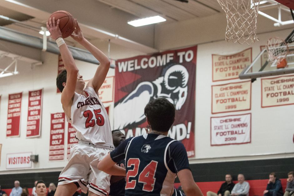Colby Hayes came off the bench to score 15 points in Cheshire's latest win, a 54-42 victory over Daniel Hand in Madison on Friday night. The Rams have won seven straight. | Justin Weekes / Special to the Record-Journal