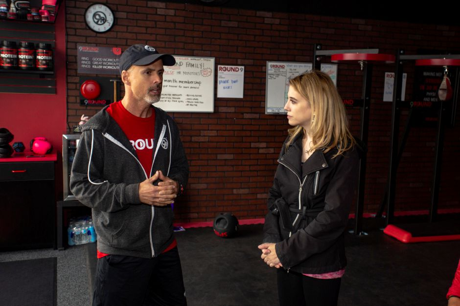 Shaun Berner, left, co-owner of 9Round Fitness talks with Record-Journal Digital Content Producer Ashley Kus about the kickboxing workout at the Wallingford facility Sept. 24, 2018. | Richie Rathsack, Record-Journal
