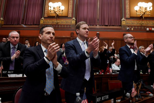 Connecticut Senate Majority Leader Bob Duff, D-Norwalk, left, and House Majority Leader Matt Ritter, D-Hartford, applaud during Gov. Ned Lamont