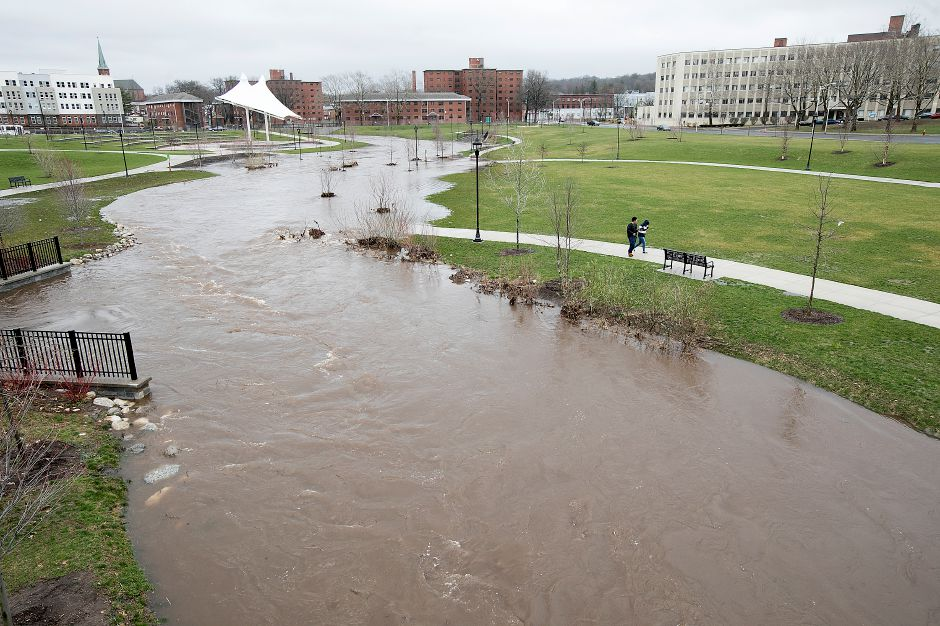 Harbor Brook rises over its banks on the Meriden Green, Monday afternoon, April 16, 2018. Dave Zajac, Record-Journal