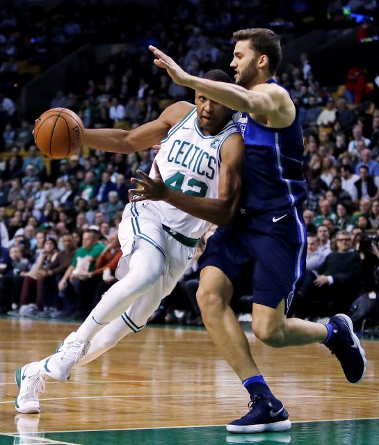 Boston Celtics forward Al Horford, left, is covered by Dallas Mavericks forward Maximilian Kleber, right, on a drive to the basket during the first quarter of an NBA basketball game in Boston, Wednesday, Dec. 6, 2017. (AP Photo/Charles Krupa)