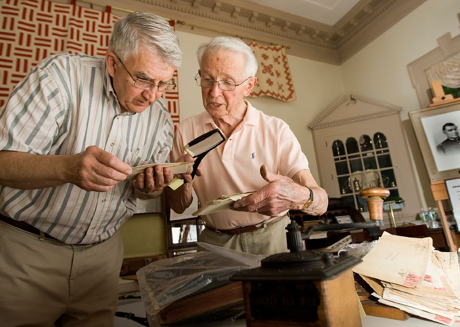 Phil Wooding, left, and Walter Hushak look over old correspondence envelopes from the Peck, Stow and Wilcox Co. at the Southington Historical Society Thursday June 2, 2011. Hushak spent 30 years working for the nearly 200-year-old company, which left the area in the 1970s. The main buildings of the old factory in downtown Southington are slated for demolition. (dave Zajac/Record-Journal)