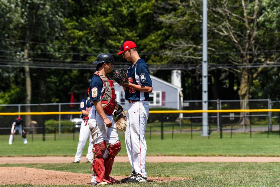 Southingtons Joshua Panarella and Ryan Henderson confer on the mound during the American Legion state championship game against Stamford at Ceppa Field on Saturday