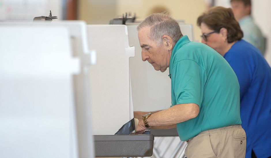 George and Debbie Cofiancesco, of Meriden, fill out their ballots at Maloney High School as voters decide whether to send the adopted 2018-19 budget back to the City Council for changes, Wednesday, July 18, 2018. Dave Zajac, Record-Journal