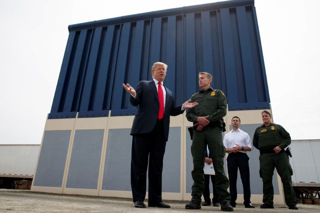 FILE - In this March 13, 2018, file photo, President Donald Trump talks with reporters as he reviews border wall prototypes in San Diego. California