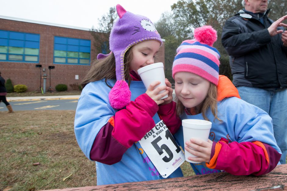 Ruby Welch 5 and twin sister Lily of Meriden enjoys some coco after the fun run Saturday during the Hot Coco 5K to benefit Abilities Without Boundaries at the Norton Elementary School in Cheshire November 18, 2017 | Justin Weekes / For the Record-Journal