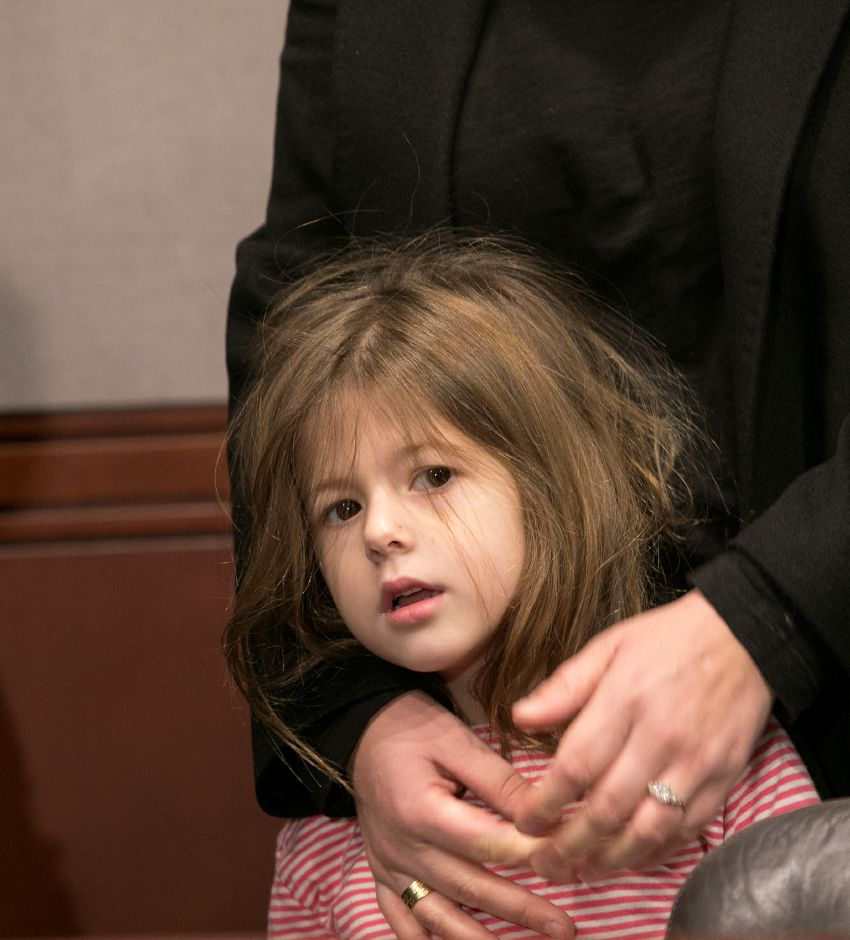 Katerina Rondos, 5, stands close to mother Denada Rondos during an appearance at the Legislative Office Building in Hartford Monday, November 13, 2017. The Department of Homeland Security issued a forbearance that stated ICE won't act to deport Denada Rondos while her appeal is being reviewed by the Second Circuit Court of Appeals. | Dave Zajac, Record-Journal
