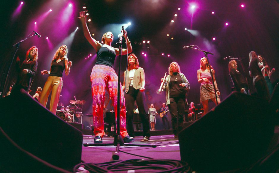 Sarah McLachlan (holding microphone) is joined by other Lilith Fair musicians including Bonnie Rait, Heather Nova and Donna Martin, during her encore at the Meadows, July 1998.