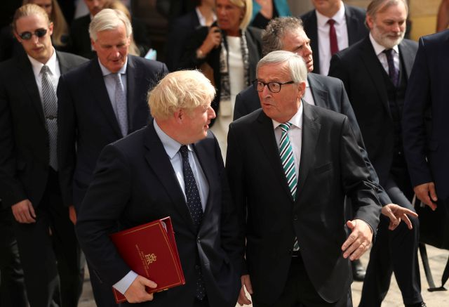 European Commission President Jean-Claude Juncker, center right, and British Prime Minister Boris Johnson, center left, leave a restaurant after a meeting in Luxembourg, Monday, Sept. 16, 2019. British Prime Minister Boris Johnson was holding his first meeting with European Commission President Jean-Claude Juncker on Monday in search of a longshot Brexit deal. (AP Photo/Francisco Seco, Pool)