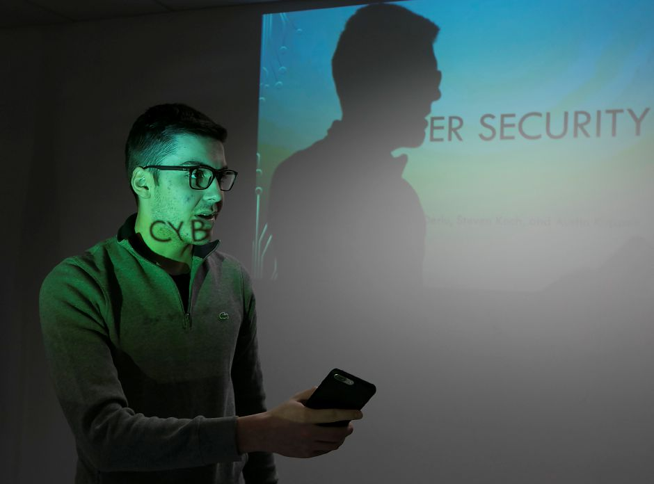 Quinnipiac University computer information systems student Vincent Deriu speaks to seniors during a cyber security workshop at Wallingford Senior Center, Wednesday, Nov. 29, 2017. Dave Zajac, Record-Journal