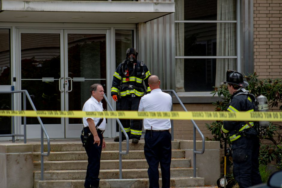 Firefighters investigate a report of a suspicious substance found in the mail room of The Money Source in Meriden Sept. 21, 2018. | Richie Rathsack, Record-Journal