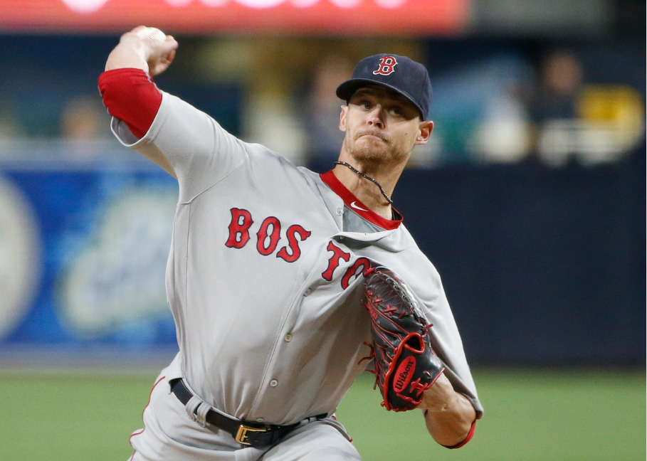 FILE - In this Sept. 6, 2016, file photo, Boston Red Sox starting pitcher Clay Buchholz works against the San Diego Padres in the first inning of a baseball game, in San Diego. The Red Sox have traded right-hander Clay Buchholz to the Philadelphia Phillies for minor league second baseman Josh Tobias, Tuesday, Dec. 20, 2016. (AP Photo/Lenny Ignelzi, File)