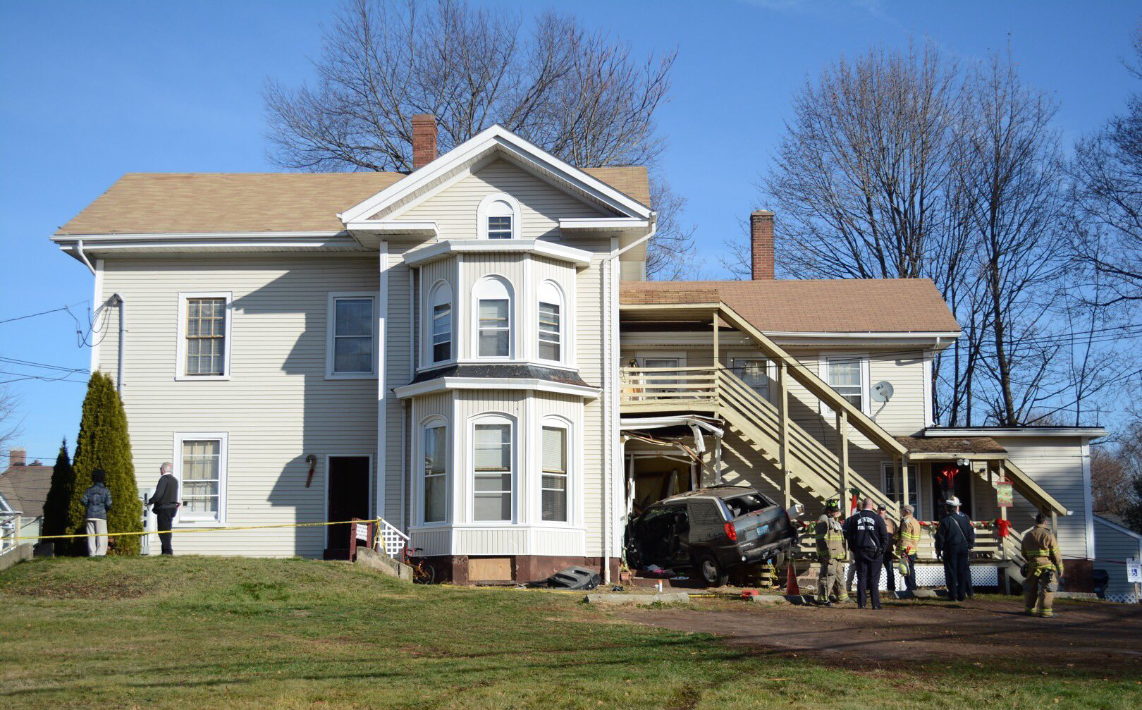 A man and woman were seriously injured after a car crashed into a home in Meriden on Tuesday, Dec. 6, 2016. | Bryan Lipiner, Record-Journal