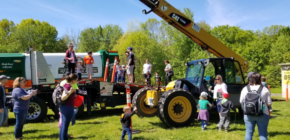 Garbage and recycling trucks, construction and flatbed trucks were a featured at the 17th annual Touch-a-Truck event at the Southington Drive-In, at 995 Meriden-Waterbury Turnpike, on Saturday, May 18, 2019. Photos by Jeniece Roman, Record-Journal
