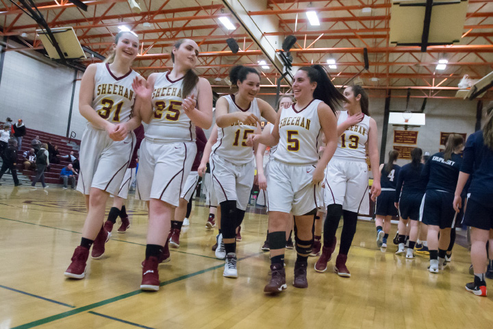 The Sheehan Titans walk off the court with their 54-51 win over Ledyard on Monday in the first round of the CIAC Class L tournament at Sheehan High School. On Thursday night, the No. 16 Titans tangle with top-seeded Holy Cross in Waterbury. | Justin Weekes / For the Record-Journal