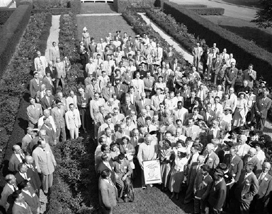 President Harry S. Truman, in front row, center, poses in the White House Rose Garden in Washington, Aug. 30, 1949, with representatives to a conference called by the President