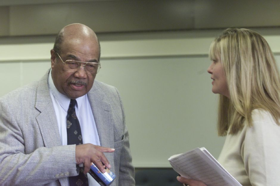 (L)Roy Gooding, of the Meriden Board of Education, speaks with Linda Langan of the Wallingford Board of Education during the Board of Governors meeting at the ACES Staff Development building in Hamden on Thursday October 10, 2002.